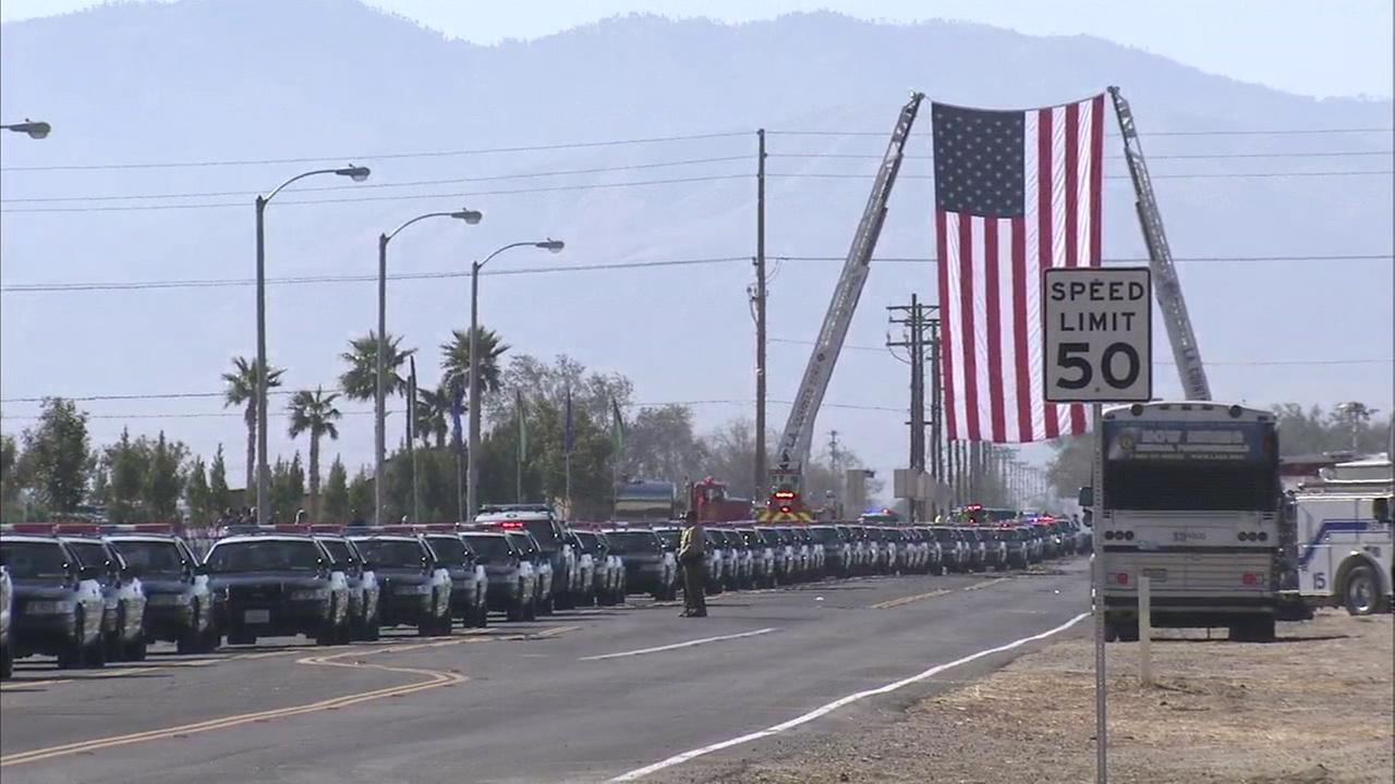 A process of law enforcement vehicles makes its way to a memorial procession of L.A. County sheriffs Sgt. Steve Owen in Lancaster on Thursday, Oct. 13, 2016.KABC
