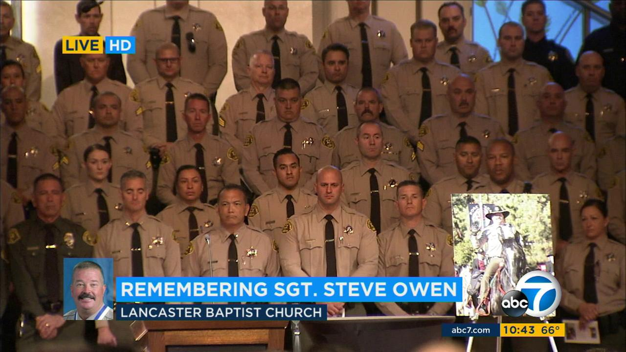 Los Angeles County Sheriffs Department deputies are seen at a memorial service for Sgt. Steve Owen in Lancaster on Thursday, Oct. 13, 2016.KABC