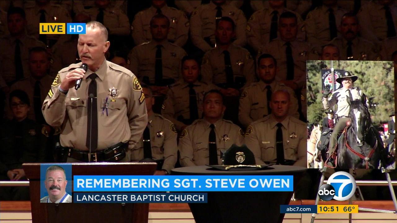 A Los Angeles County sheriffs deputy sings American Lawman at a memorial service for fallen sheriffs Sgt. Steve Owen in Lancaster on Thursday, Oct. 13, 2016.KABC