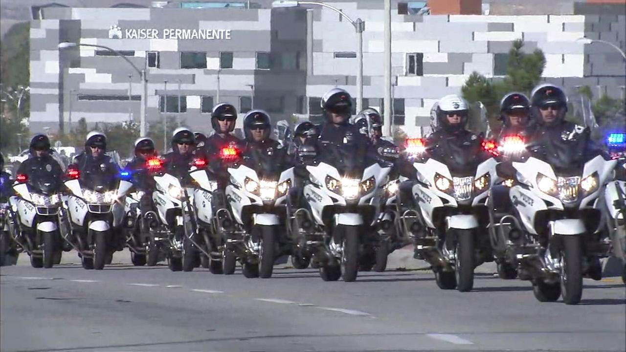 Motorcycle officers make their way through Lancaster as part of a procession in honor of fallen L.A. County sheriffs Sgt. Steve Owen on Thursday, Oct. 13, 2016.KABC