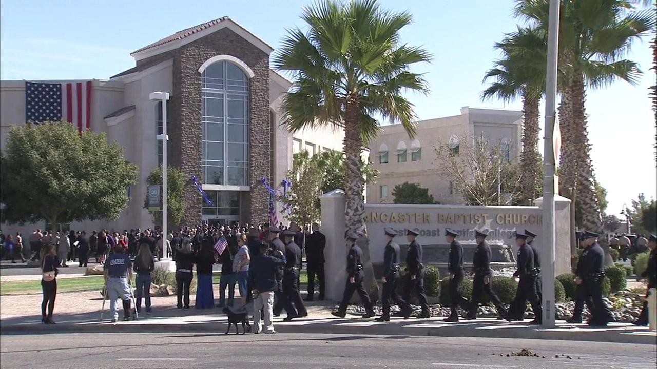 Law enforcement officers are seen in front of Lancaster Baptist Church on Thursday, Oct. 13, 2016. A memorial service was held at the church for sheriffs Sgt. Steve Owen.KABC