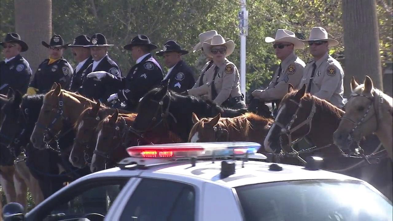 Mounted law enforcement officers are seen at a memorial service for slain L.A. County sheriffs Sgt. Steve Owen in Lancaster on Thursday, Oct. 13, 2016.KABC