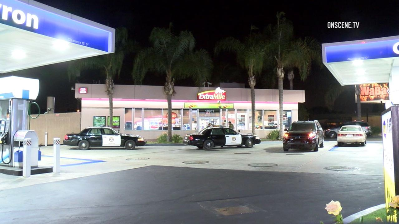 Authorities surrounded a Chevron gas station in Stanton after a man was suspected of casing it for a possible robbery on Wednesday, Oct. 12, 2016.