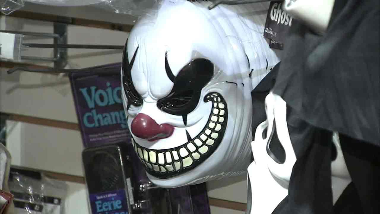 An undated photo of a scary clown mask on a store shelf.