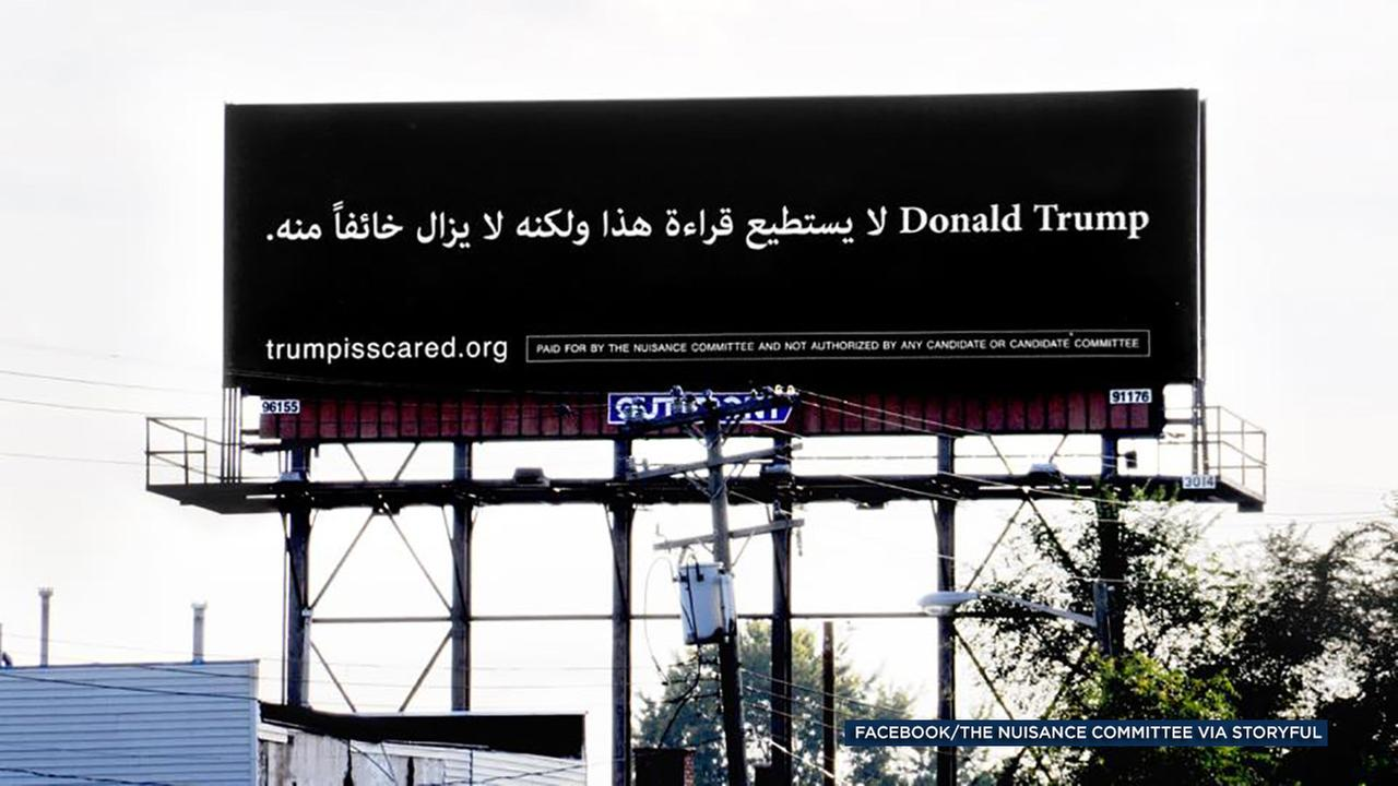 A billboard posted in Dearborn, Mich., reads, Donald Trump, he cant read this, but he is afraid of it.