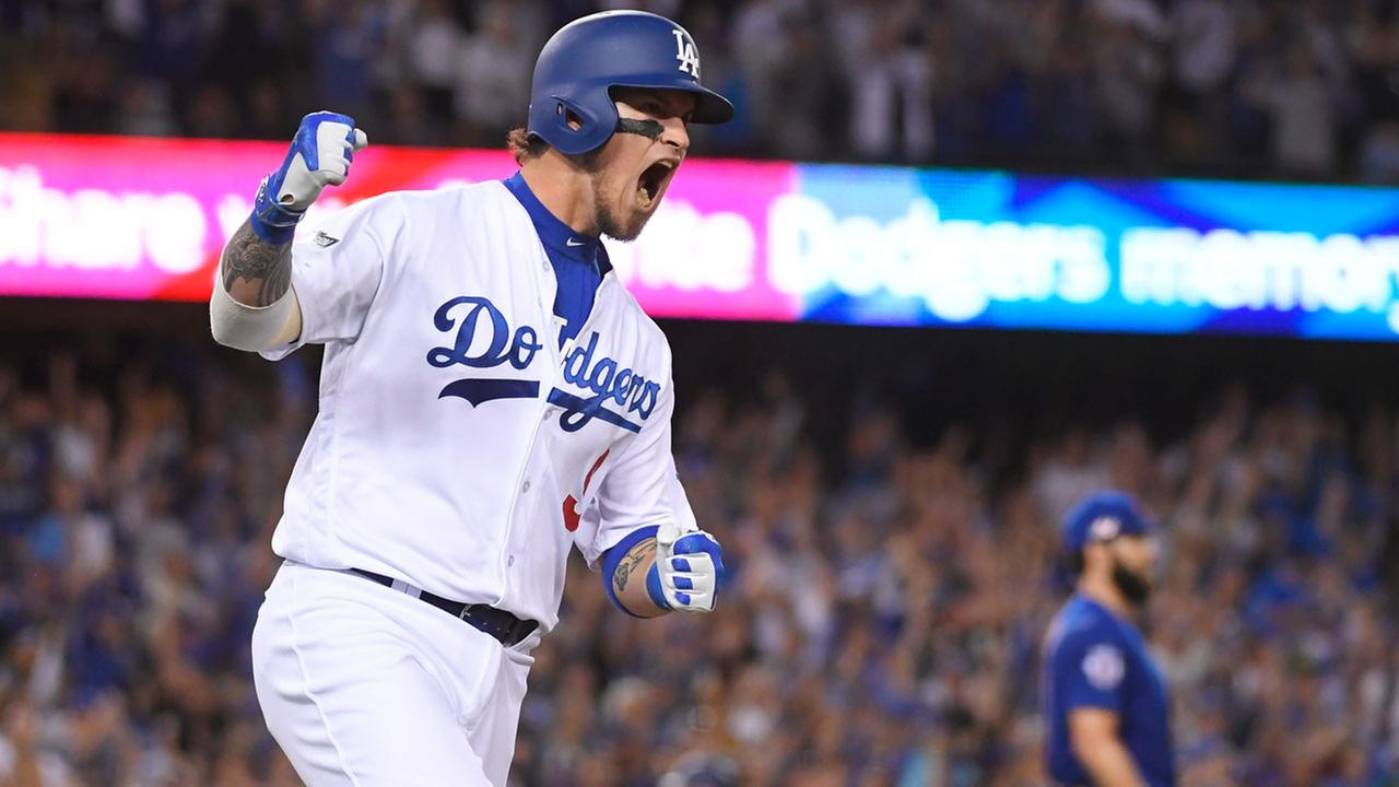 Los Angeles Dodgers Yasmani Grandal hits a two-run home run during the fourth inning of Game 3 of the NLCS against the Chicago Cubs Tuesday, Oct. 18, 2016, in Los Angeles.