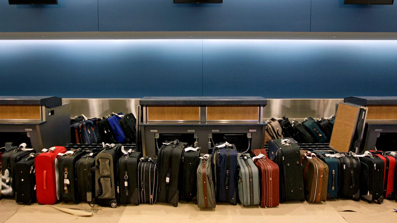 In this March 28, 2012, file photo, luggage waits to be run through the baggage system for testing in the Maynard Holbrook Jackson Jr. International Terminal at Atlantas airport.