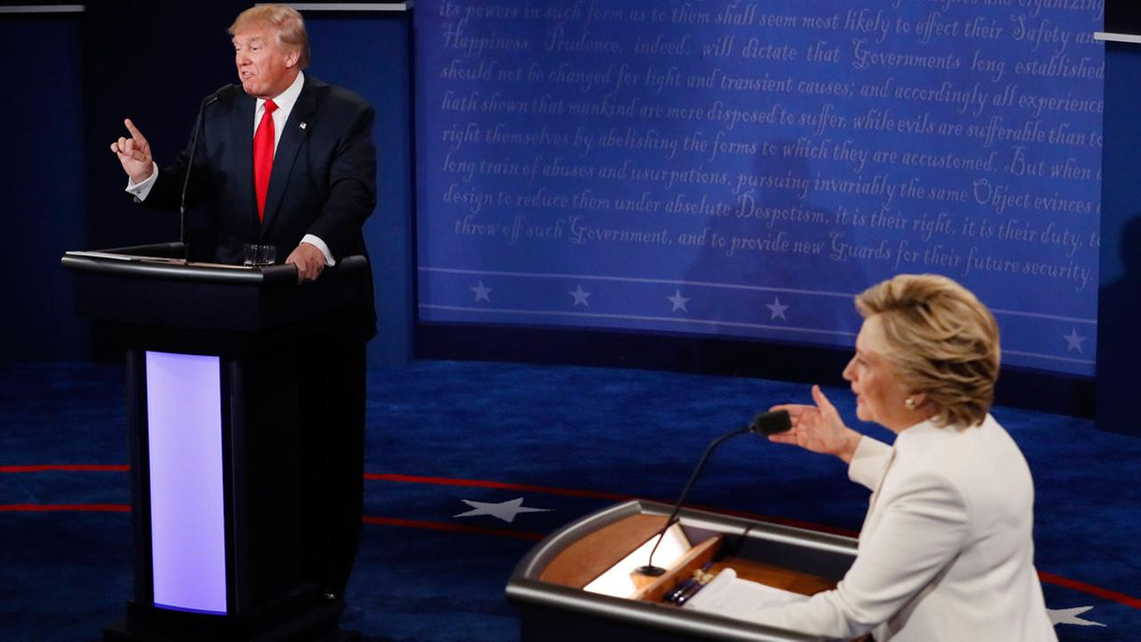 Democratic presidential nominee Hillary Clinton and Republican presidential nominee Donald Trump debate during the third presidential debate at UNLV in Las Vegas, Oct. 19, 2016.