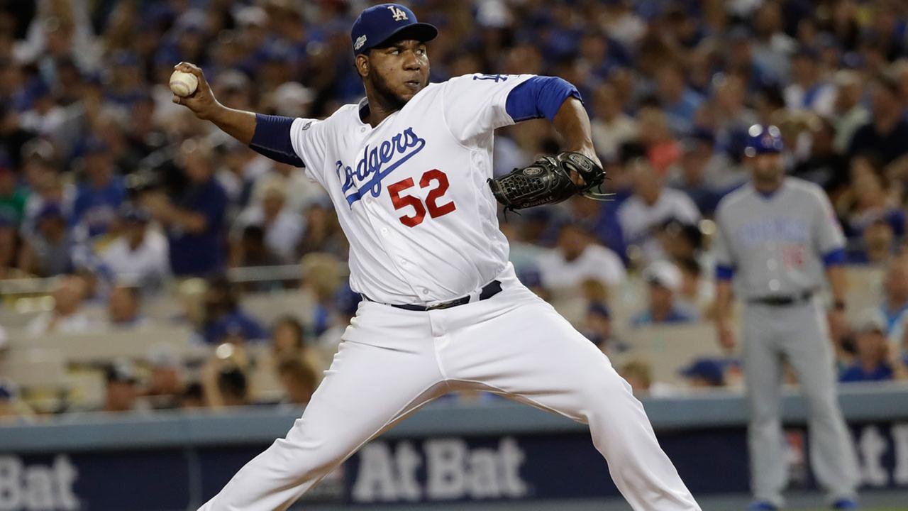 Los Angeles Dodgers relief pitcher Pedro Baez throws during the fourth inning of Game 4 of the NLCS against the Chicago Cubs Wednesday, Oct. 19, 2016, in Los Angeles.