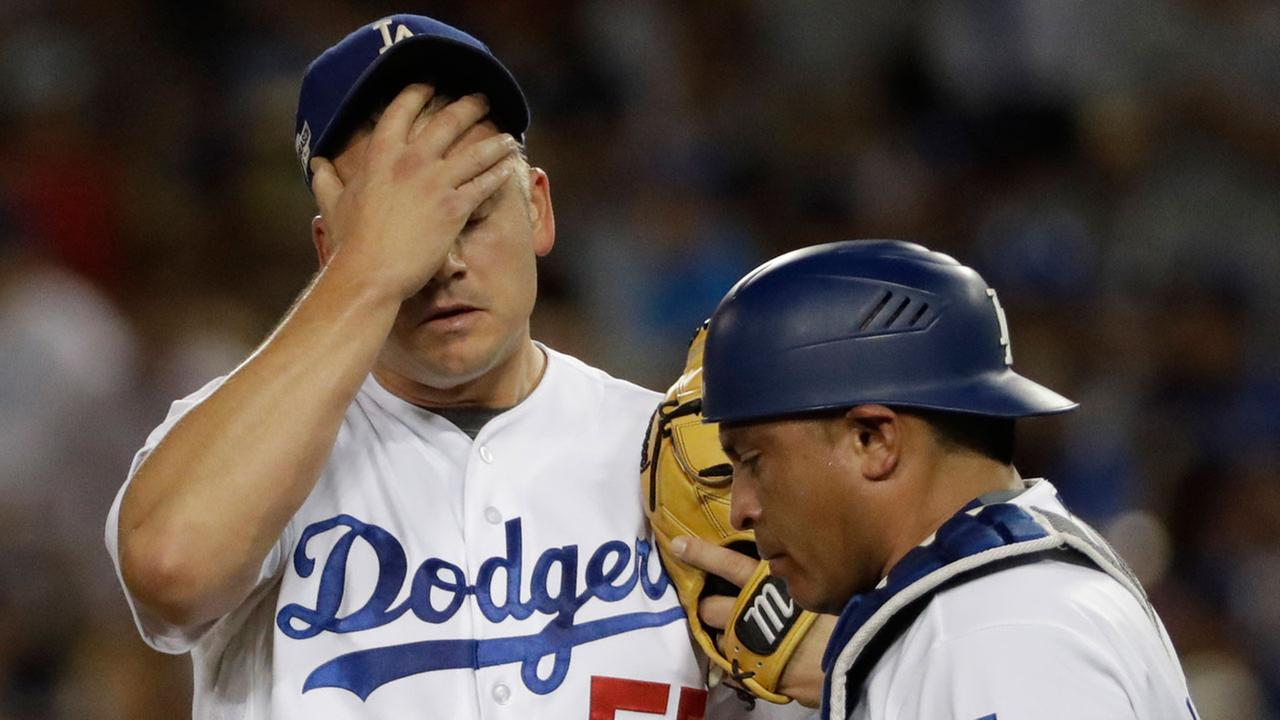 Los Angeles Dodgers Joe Blanton reacts after giving up a two-run home run to Chicago Cubs Addison Russell during the sixth inning of Game 5 of the NLCS Thursday, Oct. 20, 2016.