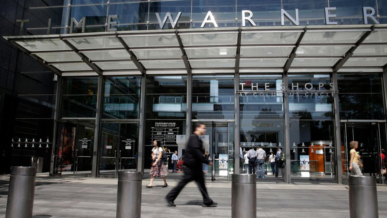 In this Tuesday, May 26, 2015 file photo, pedestrians walk by an entrance to the Time Warner Center in New York.