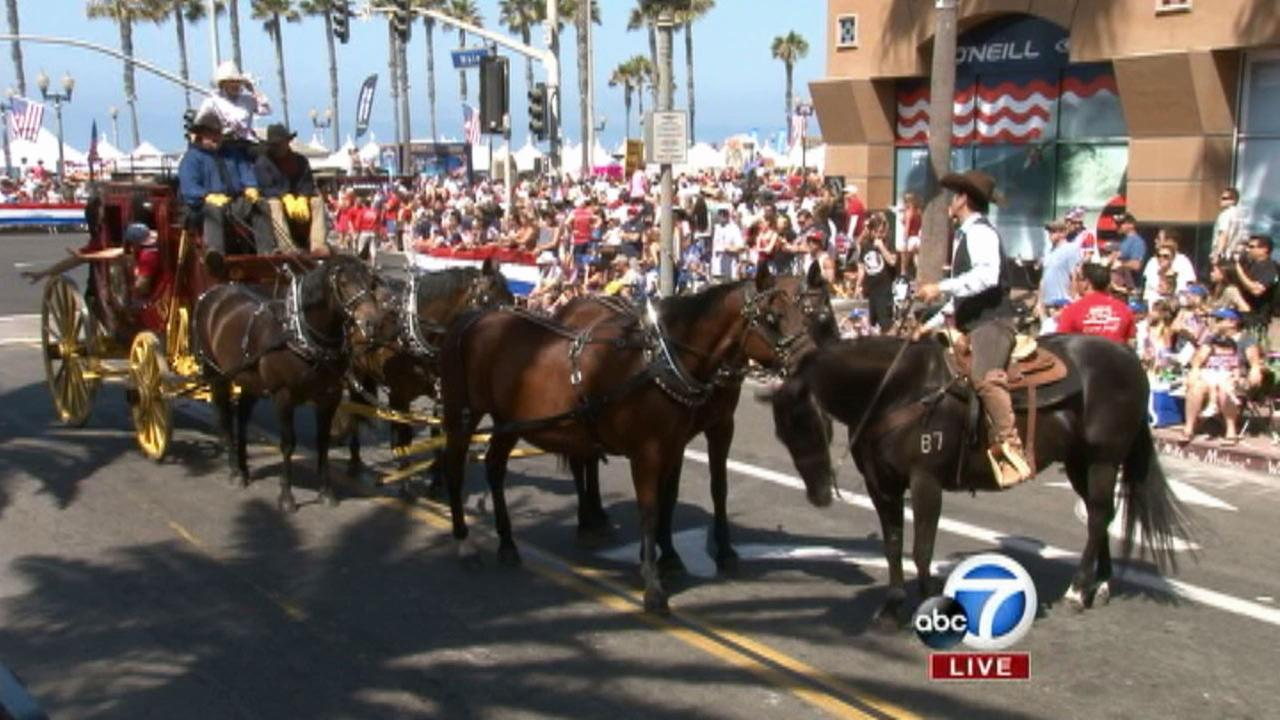 The Wells Fargo stagecoach is seen at The 4th of July Parade from Huntington Beach on Friday, July 4, 2014.