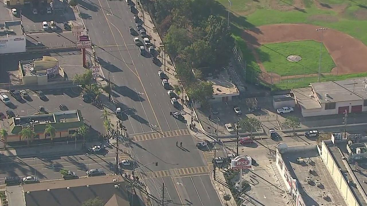 Two people were shot and wounded near Banning High School in Wilmington and the shooter remains at large, police said.