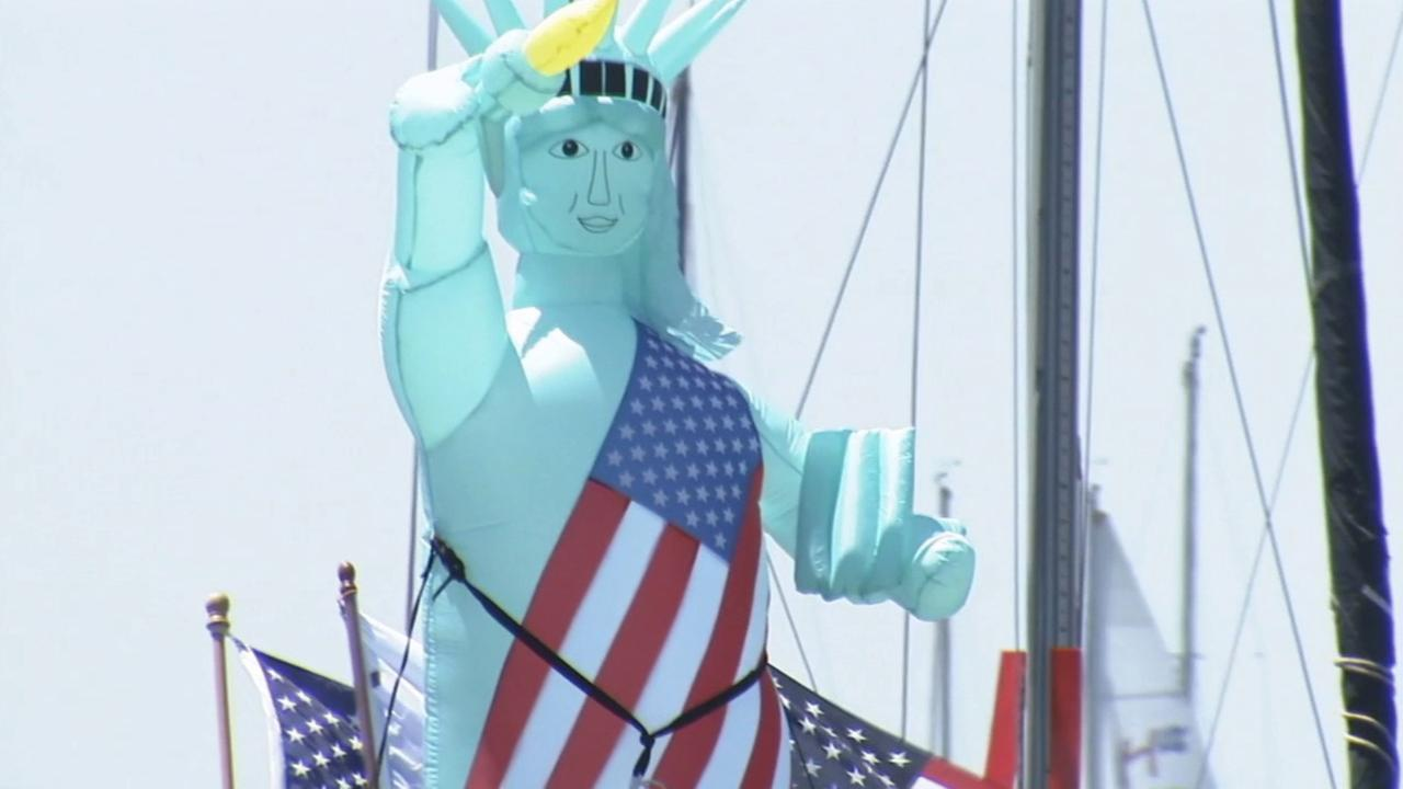An inflatable Statue of Liberty helms a boat in Newport Beachs boat parade on Friday, July 4, 2014.