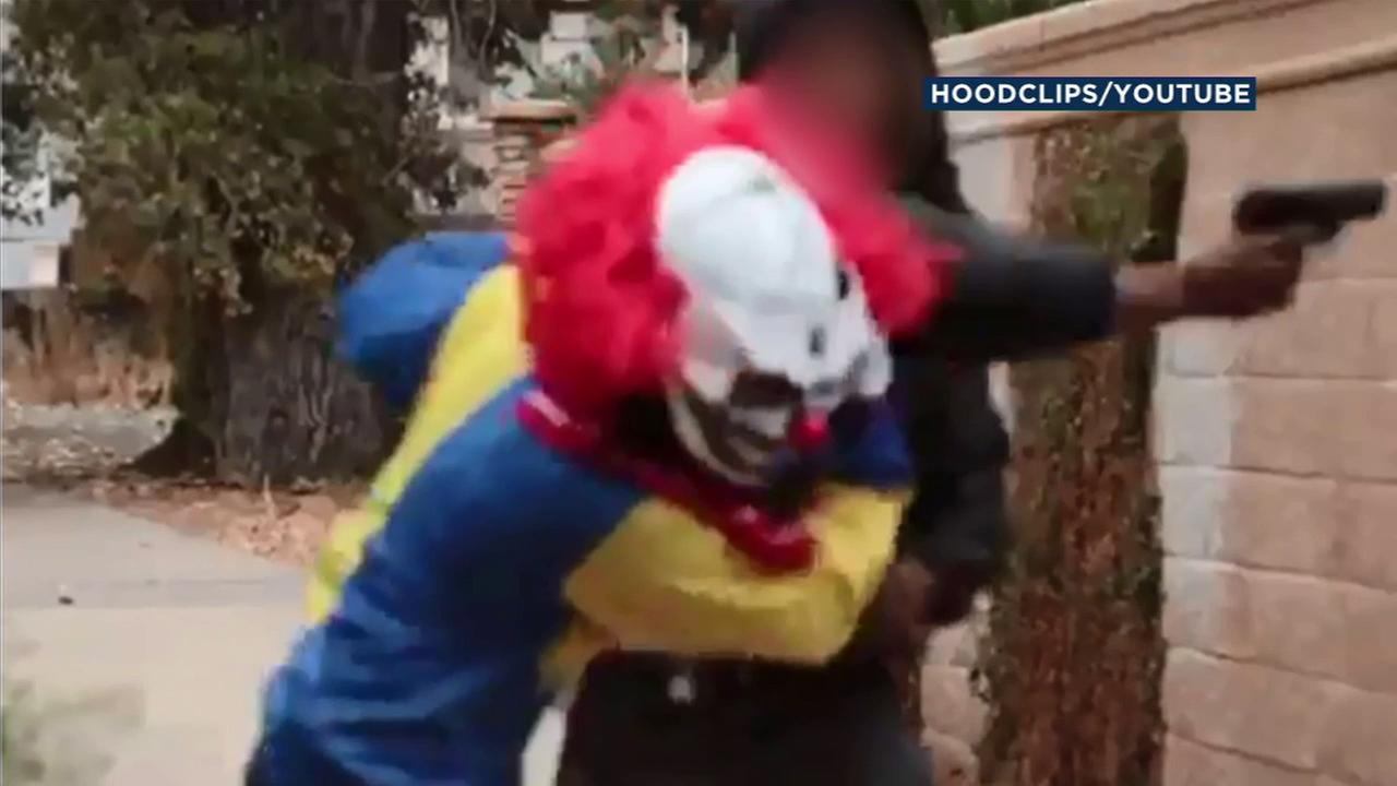 A man in a clown mask had the tables turned on him when video captured a man he attempted to scare pistol whipping the prankster.