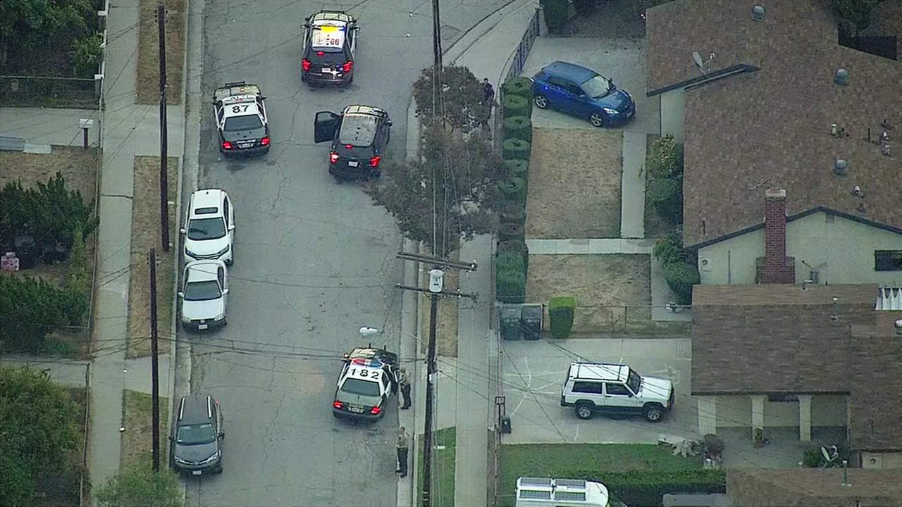 Law enforcement vehicles are seen in a San Gabriel neighborhood following a chase and an officer-involved shooting on Thursday, Oct. 27, 2016.