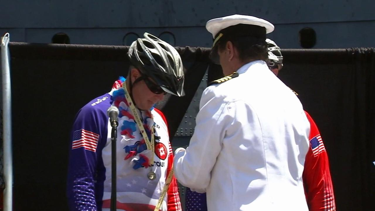 Ken Carr and Bryan Howard receive an award after biking more than 5,000 miles to raise money for disabled veterans on July 4, 2014.