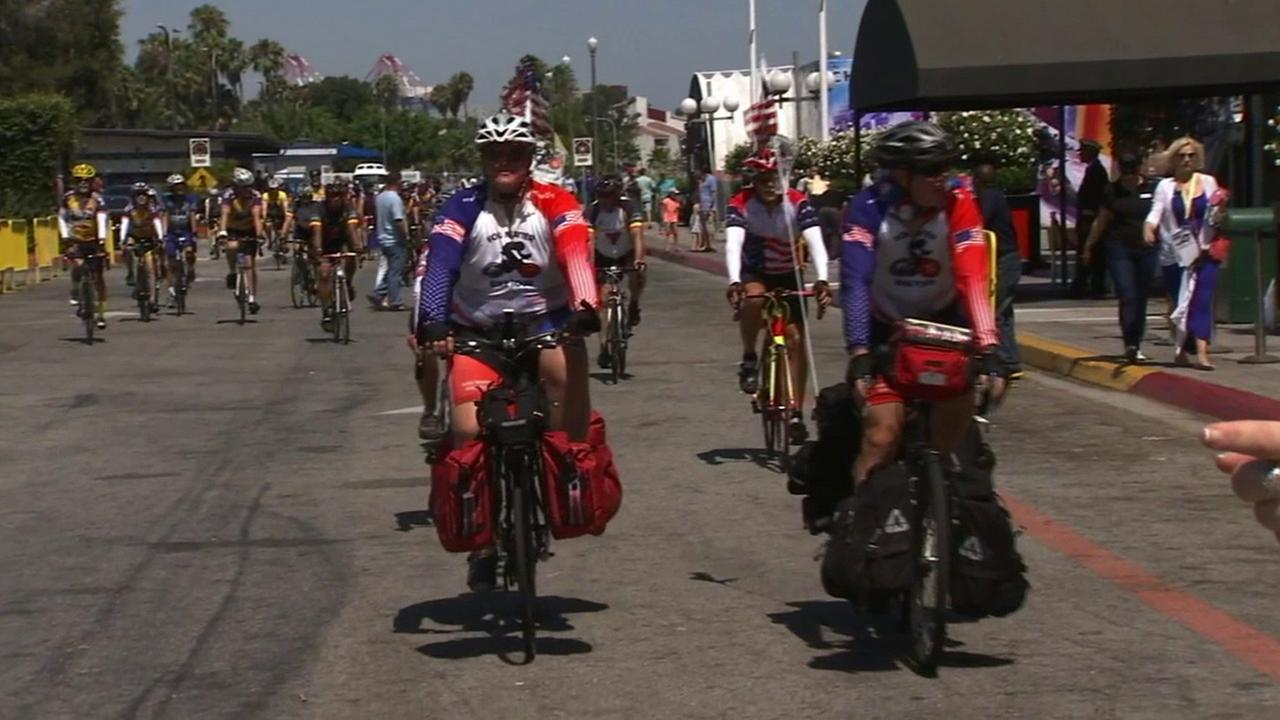 Ken Carr and Bryan Howard arrived at the Queen Mary parking lot after a two-month bike ride to raise money for disabled veterans on July 4, 2014.