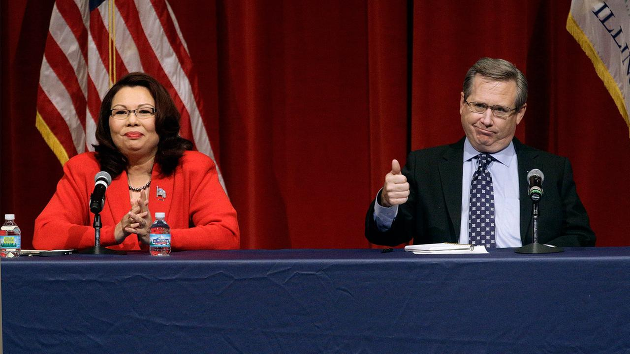 Republican U.S. Sen. Mark Kirk, right, and Democratic U.S. Rep. Tammy Duckworth, left, face off in their first televised debate Thursday, Oct. 27, 2016.