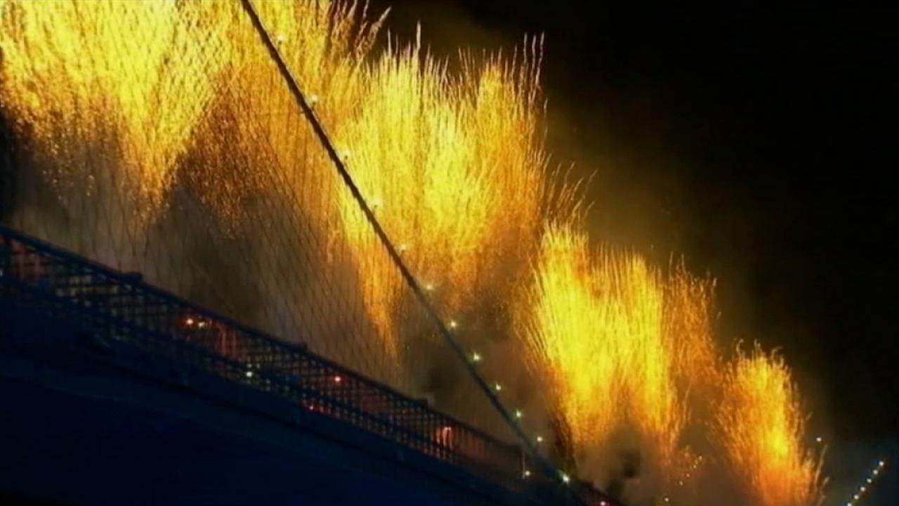 Fireworks are shot from a bridge on Friday, July 4, 2014.
