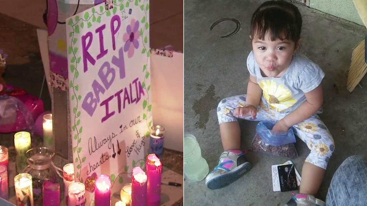 Candles and posters are seen at a Sunday night vigil dedicated to a 2-year-old girl found dead in a Fontana home on Monday, Oct. 24 ,2016.