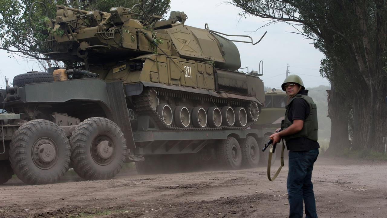 Ukrainian government forces maneuver antiaircraft missile launchers Buk as they are transported north-west from Slovyansk, eastern Ukraine Friday, July 4, 2014.
