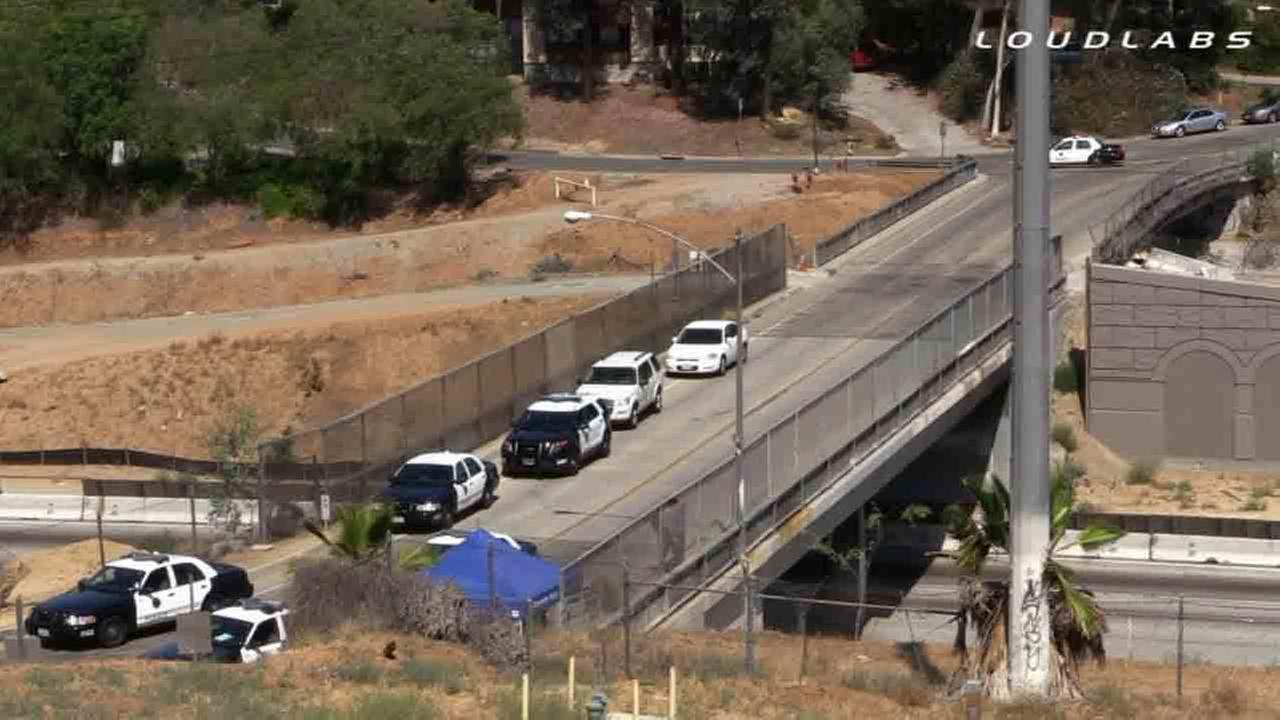 Riverside police respond to a construction zone alongside the westbound 91 Freeway where a womans body was found Saturday, July 5, 2014.