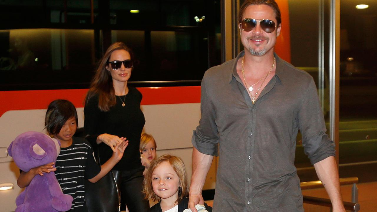 Brad Pitt, Angelina Jolie and three of their six children, pictured in 2013 in Tokyo.