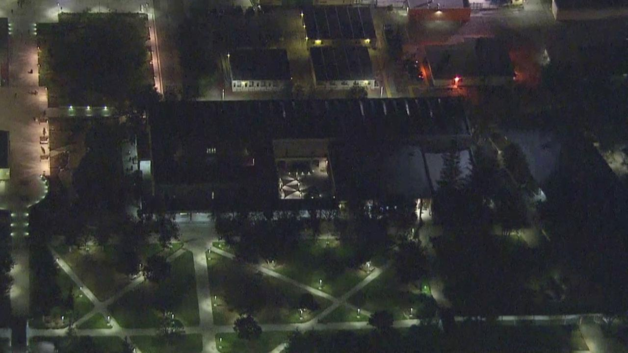 Los Angeles Valley College is shown in an aerial view as authorities check over buildings amid reports of shots fired on Wednesday, Nov. 9, 2016.