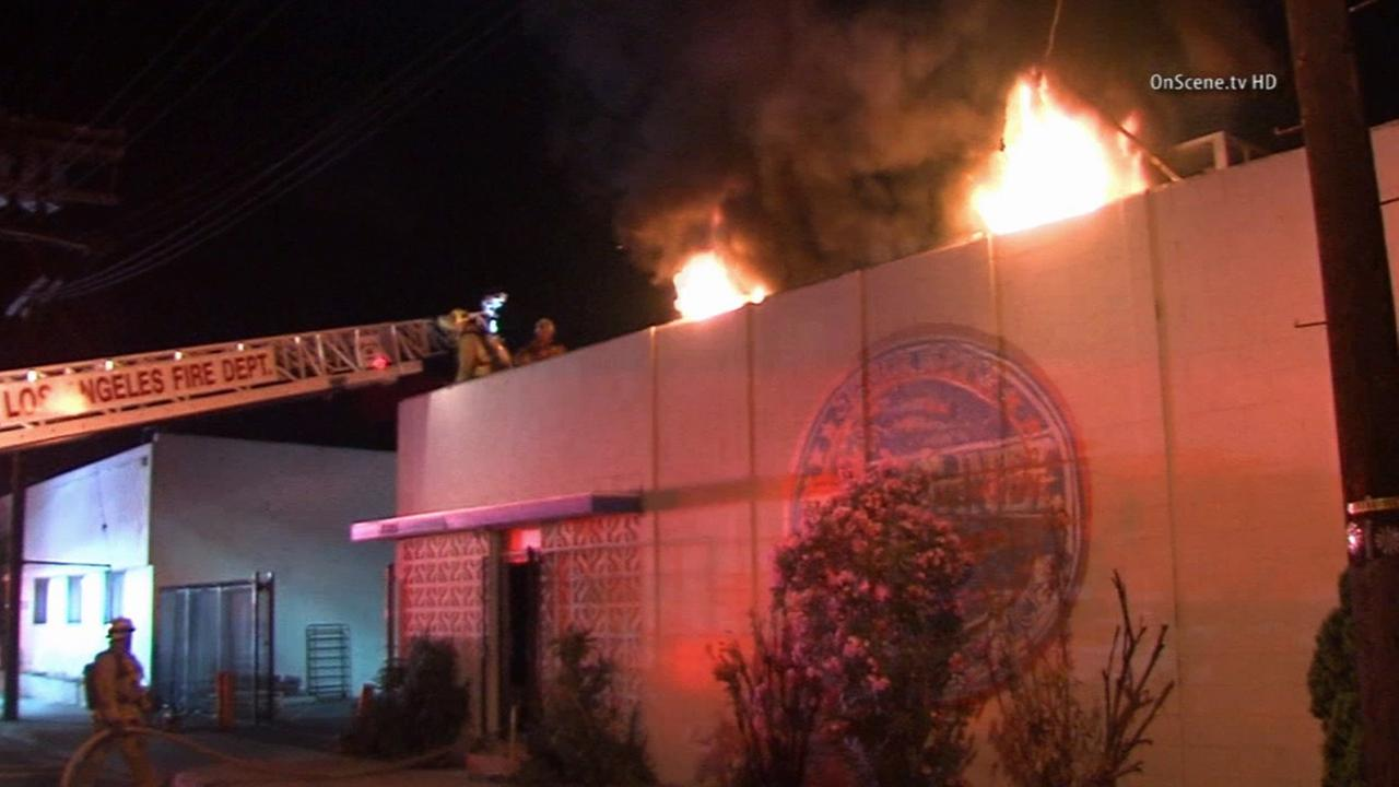 Firefighters put out a blaze at a commercial building in North Hollywood on Sunday, July 6, 2014.