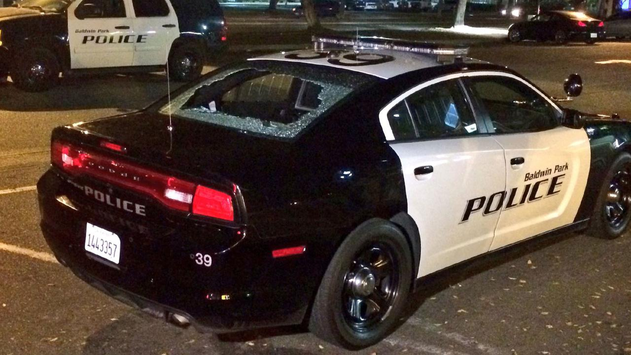 The rear window of a police car was shattered after a suspect shot it in Baldwin Park on Wednesday, Nov. 16, 2016.