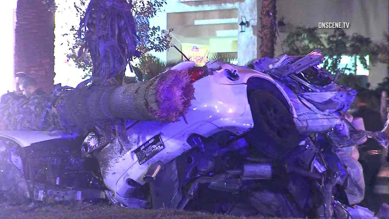 A car seen mangled next to a tree following a possible street racing crash in Pomona late Saturday, Nov. 19, 2016.