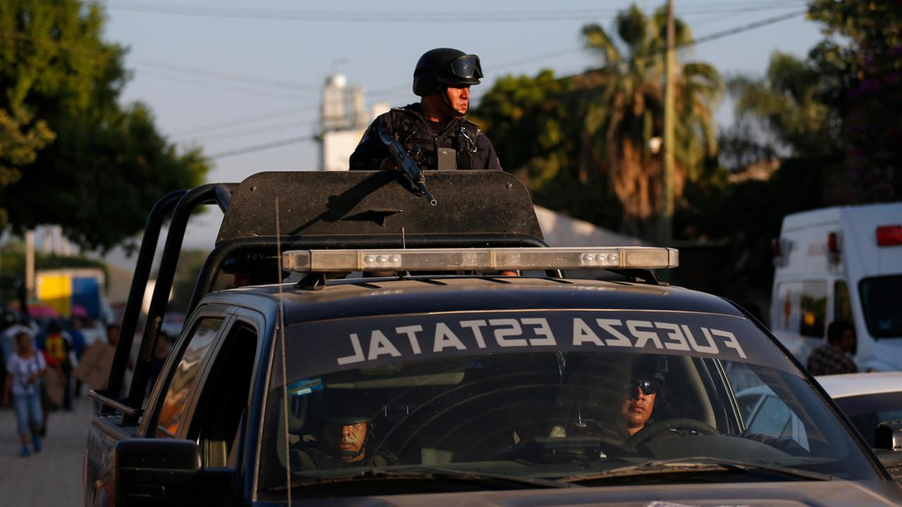 In this Dec. 2, 2015 photo, Guerrero State Police patrol in Iguala, Mexico.