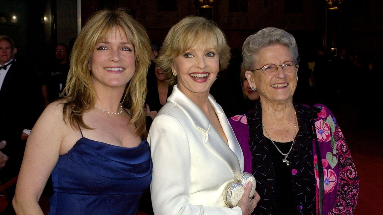 Florence Henderson, center, is flanked by fellow cast members of The Brady Bunch Susan Olsen, left, and Ann B. Davis as they arrive to ABCs 50th Anniversary Celebration in 2013.AP Photo/Kevork Djansezian