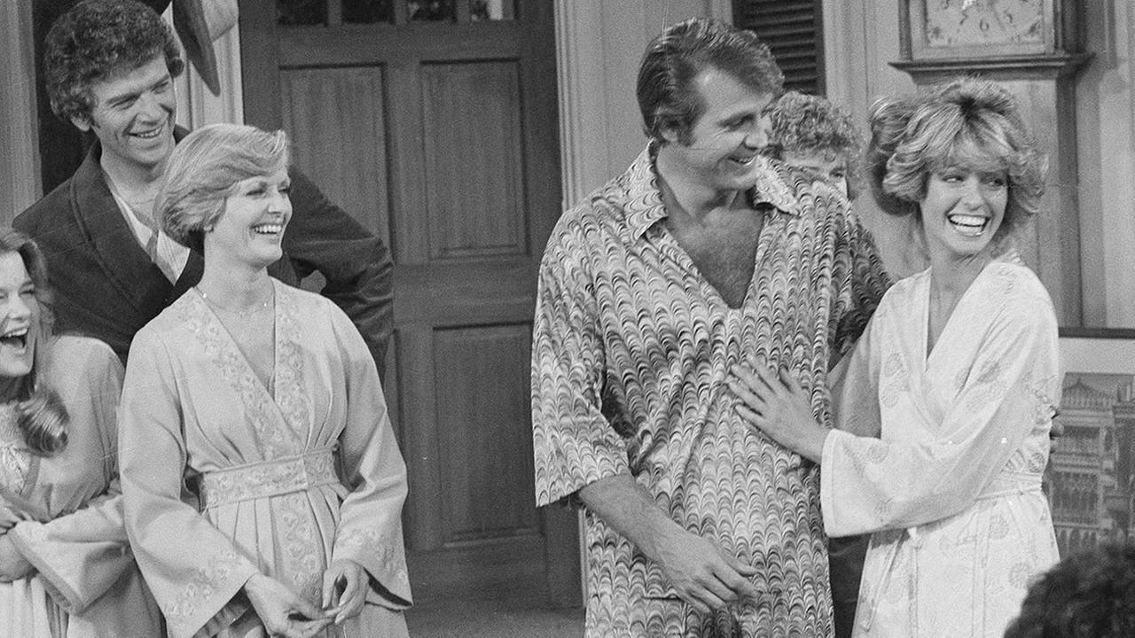 Farrah Fawcett-Majors joins husband Lee Majors in a rare TV appearance together on The Brady Bunch in 1977. At left are actors Florence Henderson, Robert Reed and Geri Reischl.AP Photo/George Brich