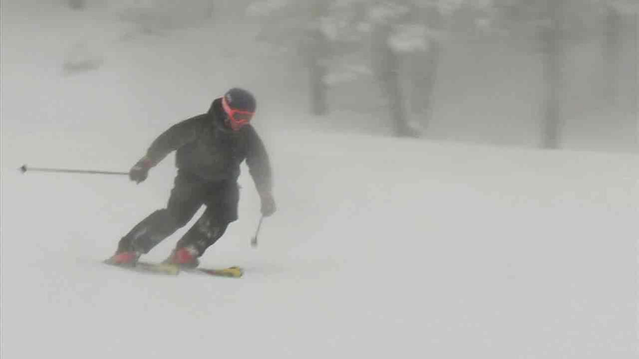 A skier on Bear Mountain enjoys the much-needed snow on Sunday, Nov. 27, 2016.
