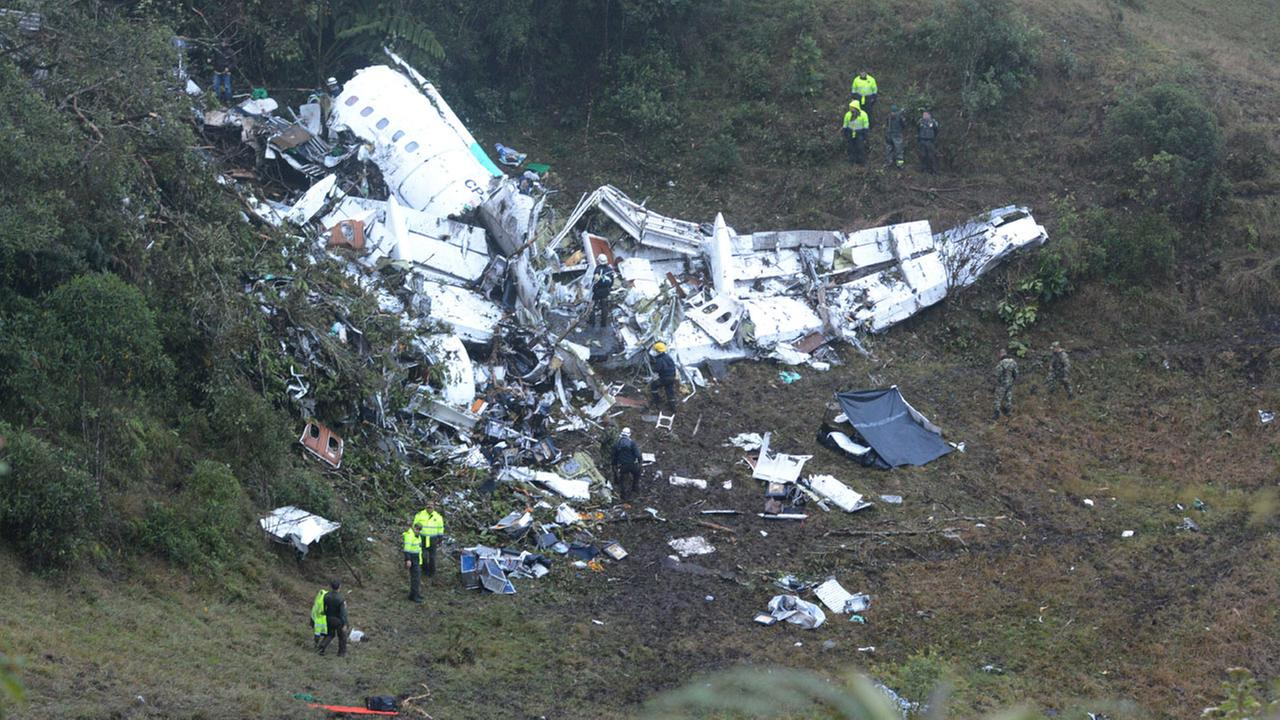Police officers and rescue workers search for survivors around the wreckage of a chartered airplane that crashed in La Union, a mountainous area outside Medellin, Colombia.