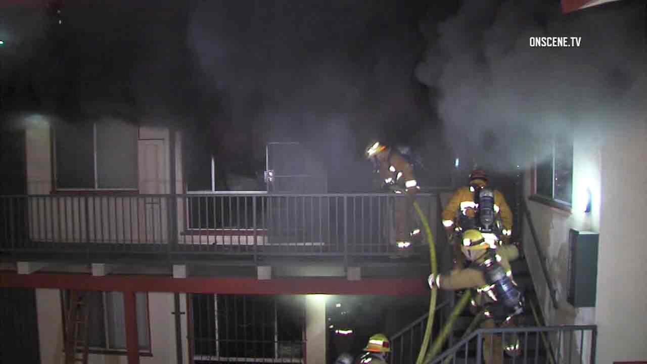 Los Angeles firefighters battle a blaze inside an apartment unit in Hyde Park on Thursday, Dec. 8, 2016.