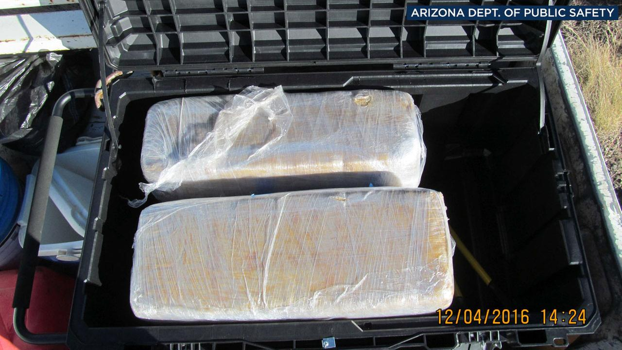 Arizona authorities took photos of nearly $70,000 worth of pot that was found in the bed of a pick-up truck that three notably-named men were carrying on Sunday, Dec. 4, 2016.