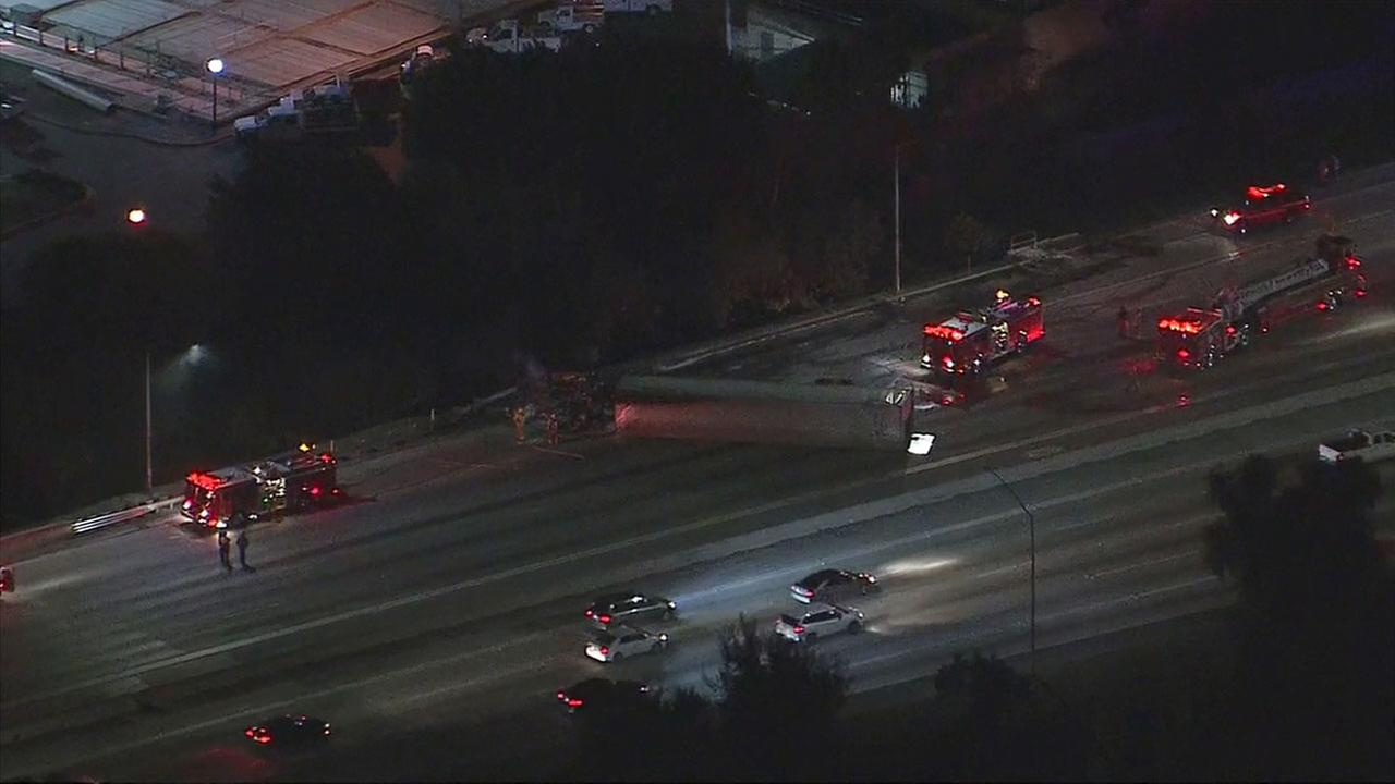 An overturned big rig caught on fire and was blocking the 605 Freeway at Valley Blvd.