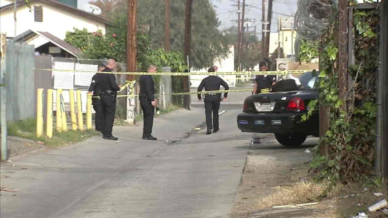 Los Angeles police investigate a double-homicide in South L.A. on Saturday, Dec. 10, 2016.