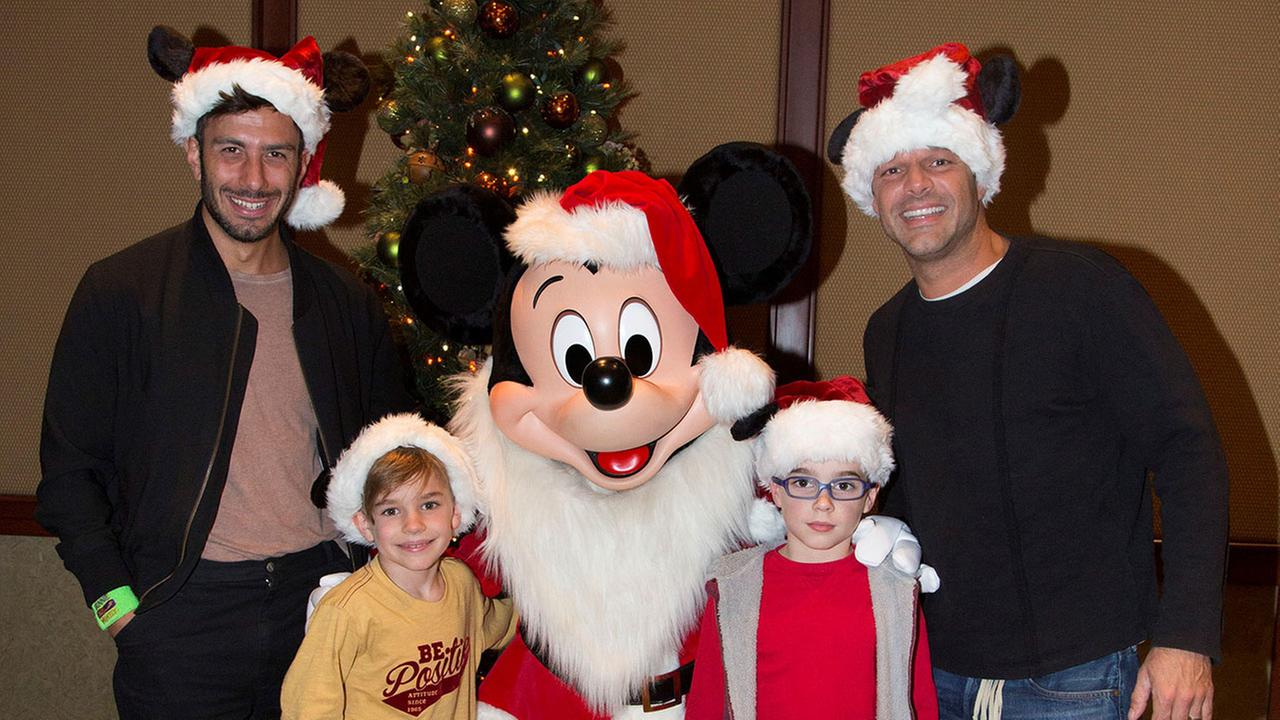 Singer Ricky Martin meets Mickey Mouse with his twin 8-year-old sons Matteo and Valentino and fiance Jwan Yosef at Disneyland in Anaheim on Tuesday, Dec. 13 ,2016.Scott Brinegar/Disneyland Resort