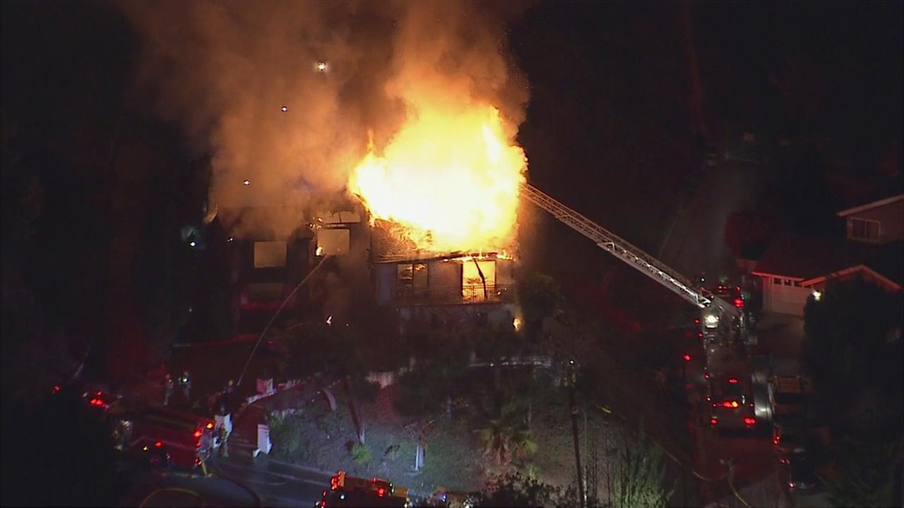 Massive flames emanated from a two-story house in Glendale as firefighters worked to extinguish the blaze on Monday, Dec. 19, 2016.