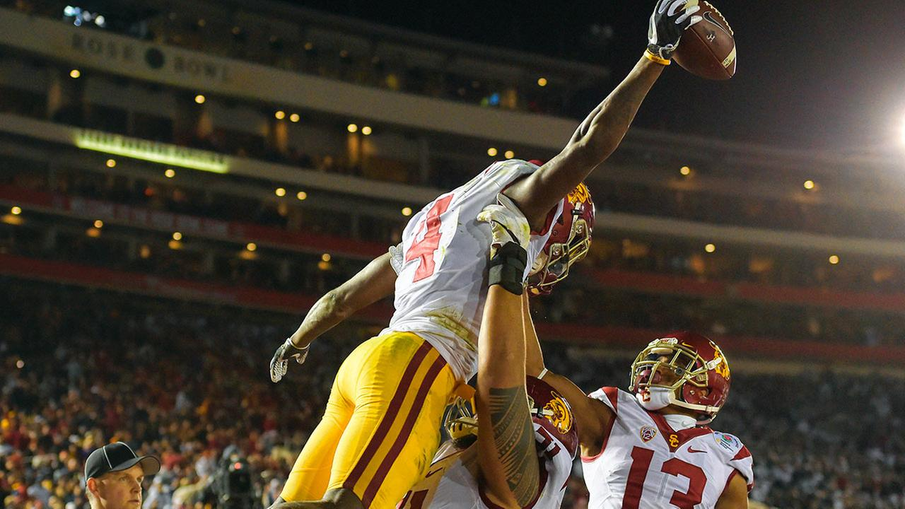 Southern California running back Ronald Jones II, left, celebrates with DeQuan Hampton, right, and Damien Mama after scoring during the Rose Bowl on Monday, Jan. 2, 2017.