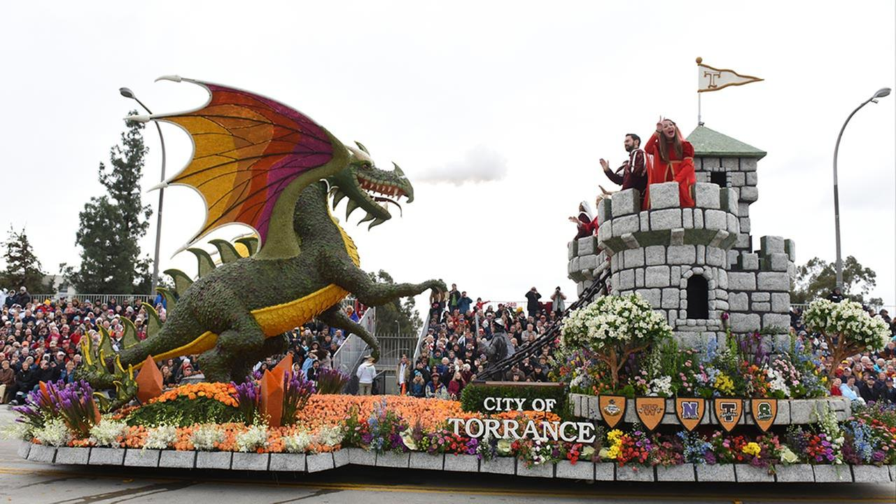 The City of Torrance, Calif., float Be Your Own Knight winning entry, the Tournament Volunteer Trophy for most best floral design 35 feet and under, rolls along the Rose Parade. AP Photo/Michael Owen Baker