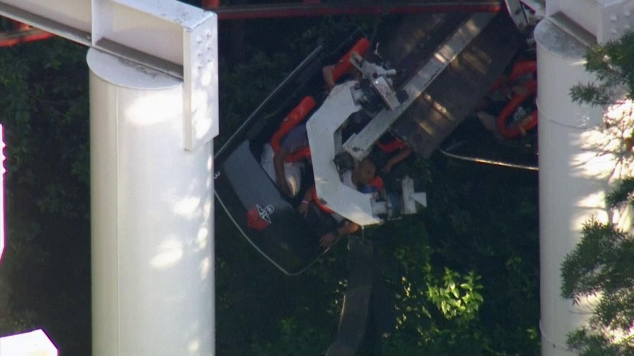Riders were stuck after a branch fell onto the Ninja roller-coaster at Six Flags Magic Mountain on Monday, July 7, 2014.