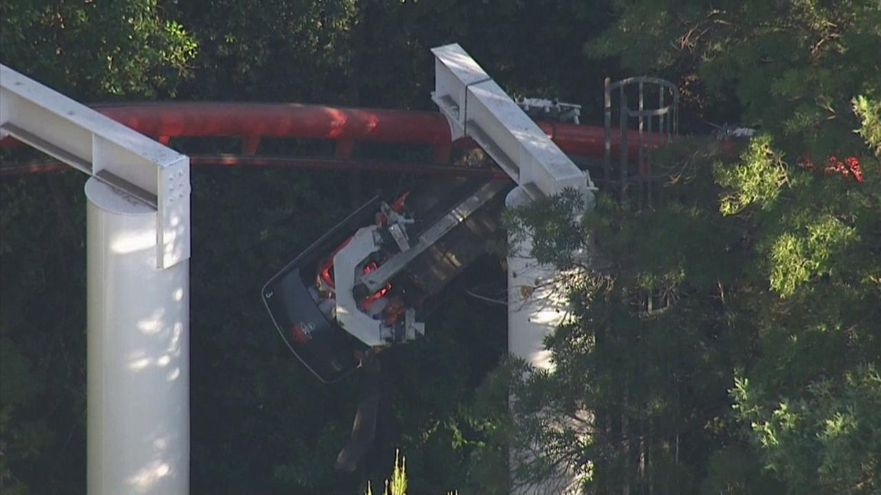 Riders were stuck after a branch fell onto the Ninja roller coaster at Six Flags Magic Mountain on Monday, July 7, 2014.
