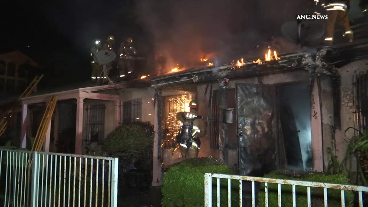 Los Angeles Fire Department Firefighters Battle A At House In Hyde Park On Sunday