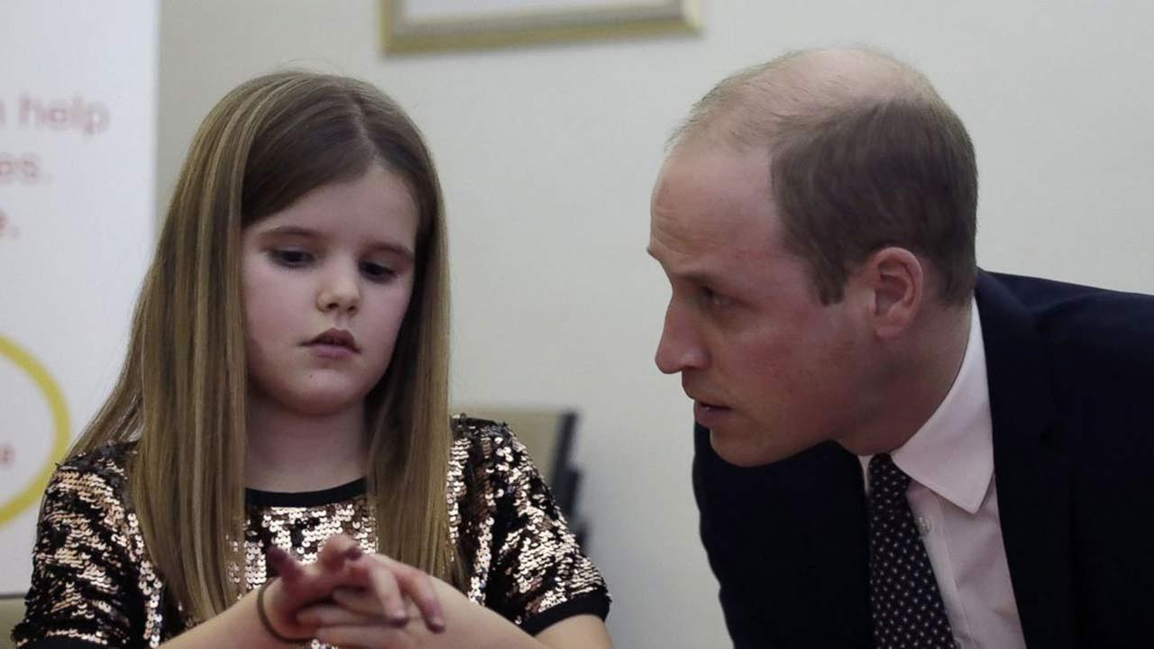 In this Wednesday, Jan. 11, 2017 file photo, Britains Prince William speaks to Aoife, 9, during his visit to a Child Bereavement UK Centre in Stratford in east London.