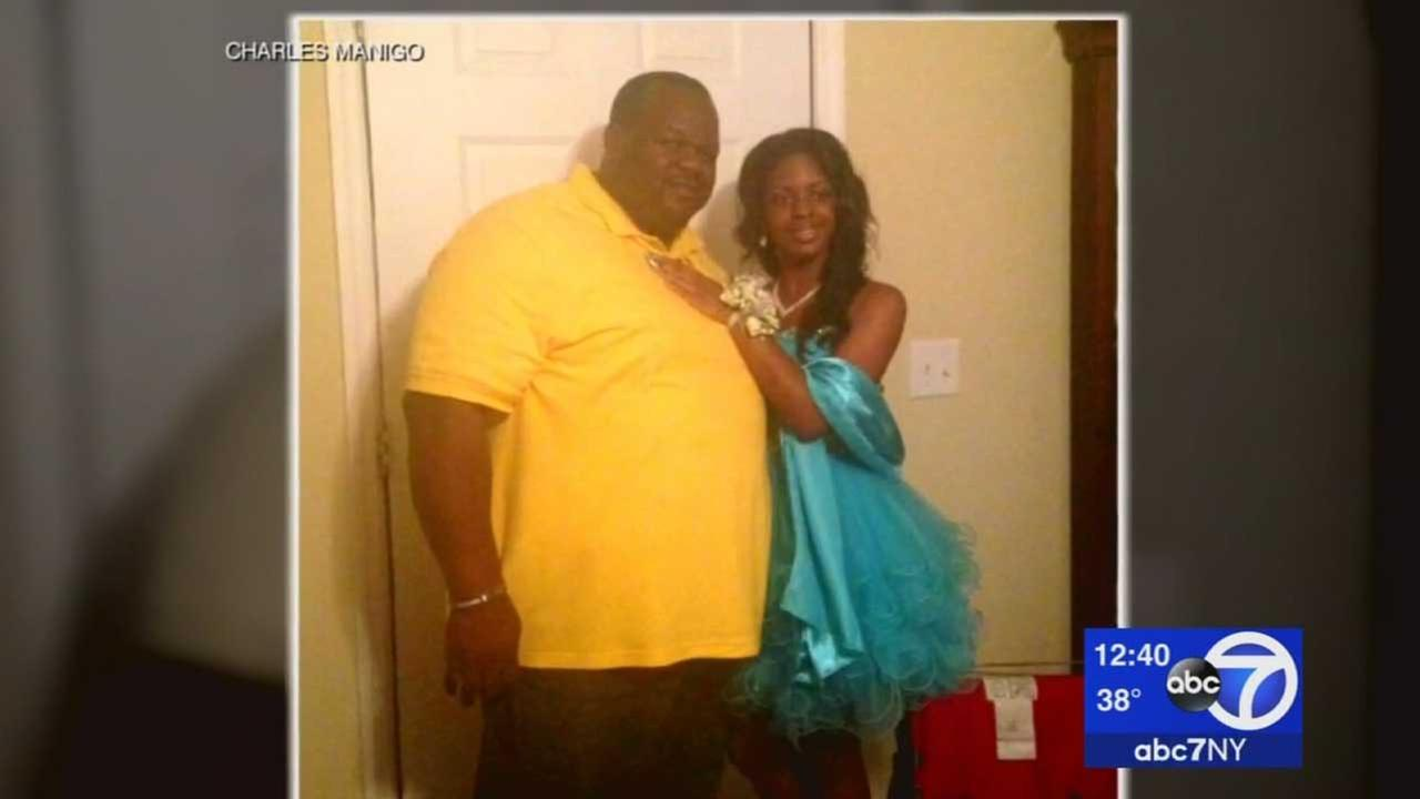 Charles Manigo is seen in a photo posing with who he thought was his biological daughter, who he named Alexis Kelli.